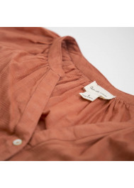Woman's orange blouse